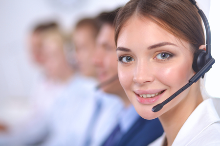 business centre: Attractive  positive young businesspeople and colleagues in a call center office Stock Photo