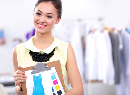 only young women: Modern young fashion designer working at studio