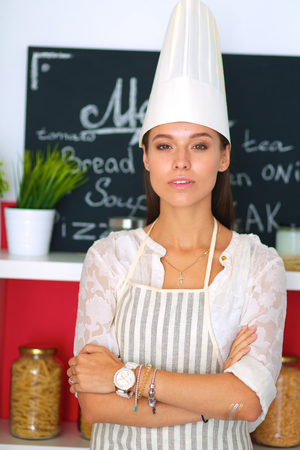 culinary skills: Chef woman portrait with  uniform in the kitchen .