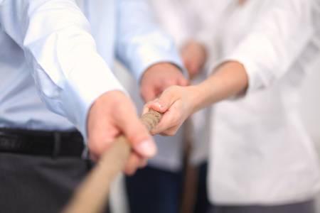 Concept image of business team using a rope as an element of the teamwork Stockfoto