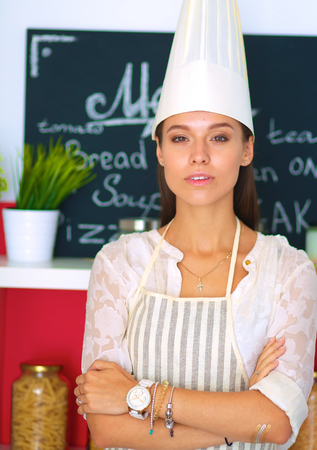 culinary skills: Chef woman portrait with uniform in the kitchen