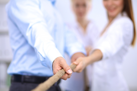 tug: Concept image of business team using a rope as an element of the teamwork Stock Photo