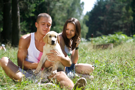 mate married: A smiling couple with their dog outdoors.