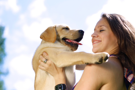 endear: Girl with her dog resting outdoors.