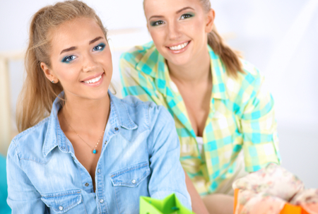 mixed race ethnicity: Two young women sitting with laptop  and credit cart Stock Photo