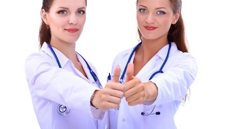 medical decisions: Two young woman doctor showing ok , standing in hospital. Stock Photo