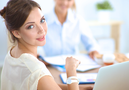 confident business woman: Business people sitting and discussing at business meeting.