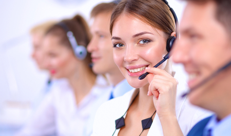 telephone: Attractive  positive young businesspeople and colleagues in a call center office Stock Photo