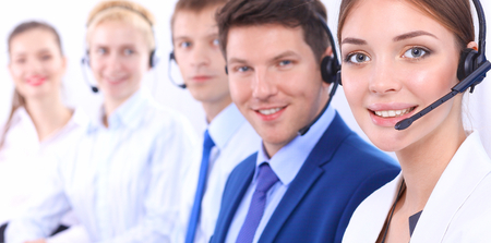 support group: Attractive  positive young businesspeople and colleagues in a call center office Stock Photo