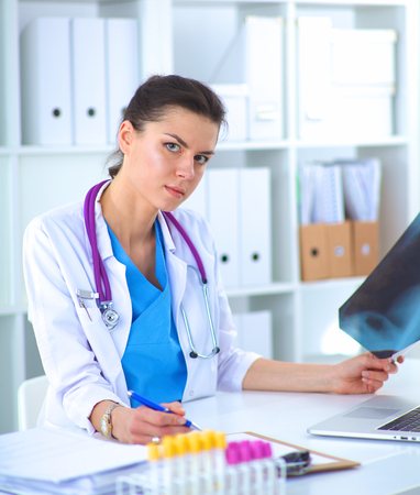 co operation: Medical team sitting at the table in modern hospital. Stock Photo