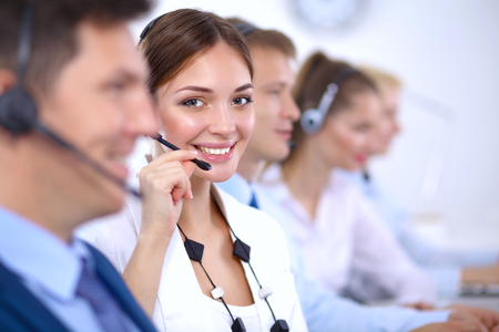 phone support: Attractive  positive young businesspeople and colleagues in a call center office Stock Photo