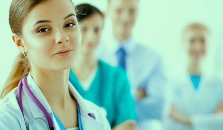 physiotherapists: Attractive female doctor in front of medical group .