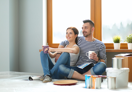 resting: Portrait of young couple moving in new home. Stock Photo