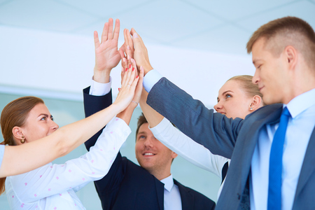 joining hands: Business team joining hands together