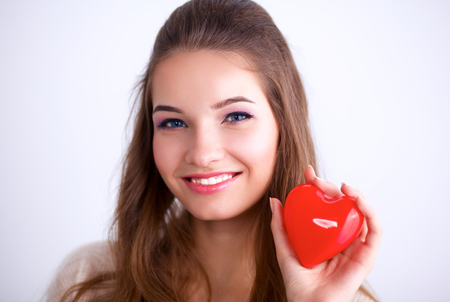 beguin: Beautiful woman hold red heart.
