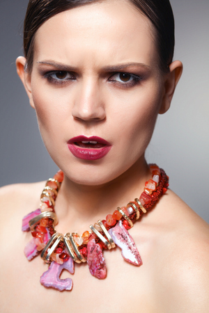 Portrait of young beautiful brunette woman in beads . Stock fotó