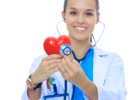 pulmology: A doctor with stethoscope examining red heart, isolated on white