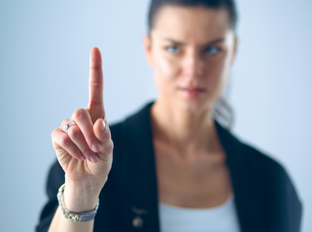 press button: Woman touching an imaginary screen with her finger.