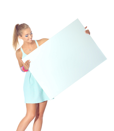 Young woman with blank board banner, isolated on white background Stock Photo