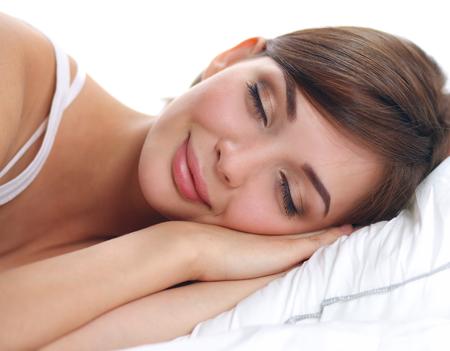 Beautiful girl sleeps in the bedroom, lying on bed, isolated Stock Photo