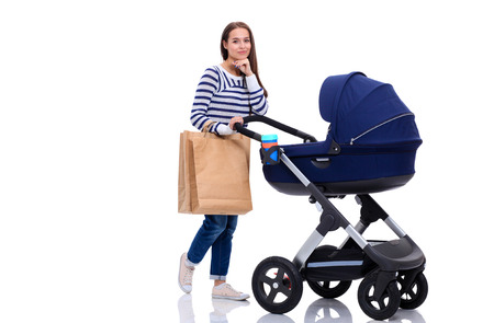 shopping buggy: Full length portrait of a mother with a stroller, isolated on white background