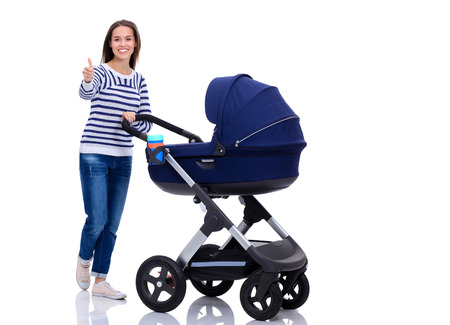 mammy: Full length portrait of a mother with a stroller showing ok, isolated on white background