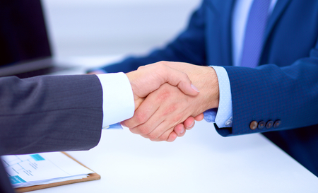 altogether: Business people shaking hands, finishing up a meeting, in office