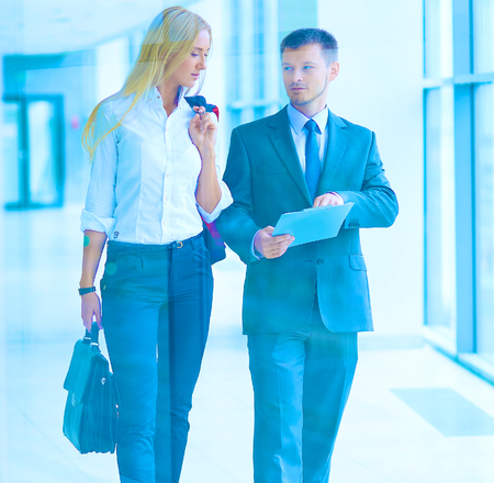 Businesspeople walking in the corridor of an business center.