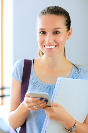 Woman use of mobile phone in university Stock Photo