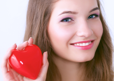 Beautiful woman hold red heart.