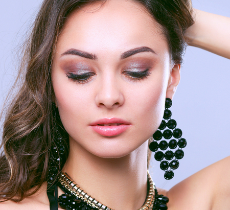 jewerly: Portrait of a beautiful woman with necklace. Stock Photo