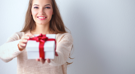 anniversary sale: Young woman happy smile hold gift box in hands.
