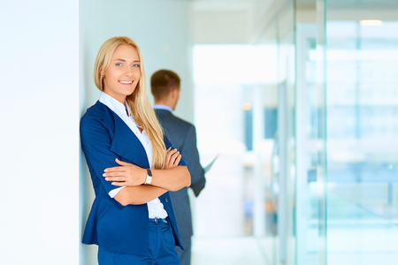 personable: Businesswoman standing in a modern building