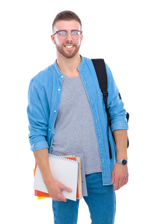 A male student with a school bag holding books isolated on white background