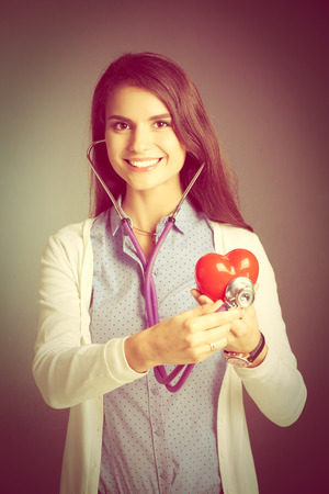 pulmology: A doctor with stethoscope examining red heart