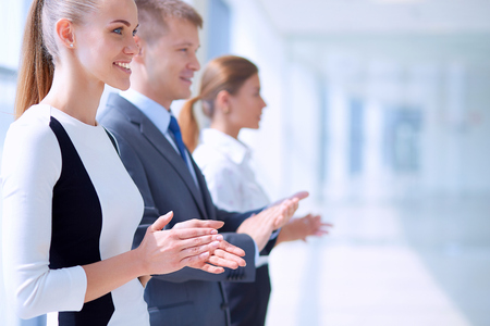 Smiling business people applauding a good presentation in the office. Stock Photo