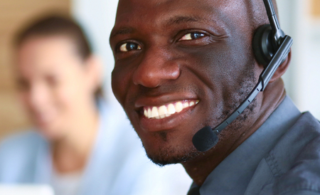 african business: Portrait of an African American young business man with headset.