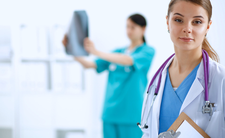 Portrait of woman doctor standing in the hospital.