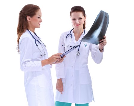 collegue: Portrait of two successful female doctors holding a writing pad and x-ray.