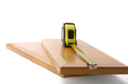 Wooden board and tools on a white background.