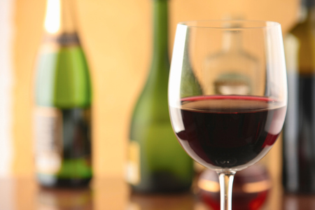glass of red wine: Glass of red wine and the wine bottle.