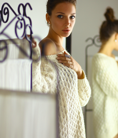 Portrait of a cute woman in sweater at home