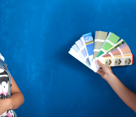 Two Young beautiful weman holding color palette with color samples. Stock Photo
