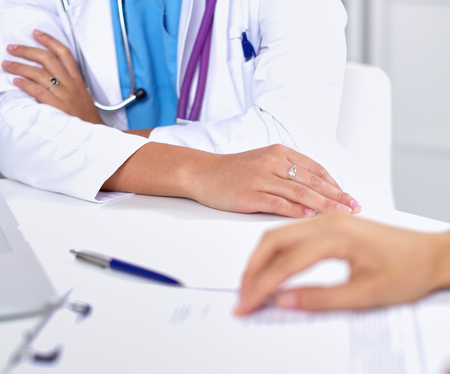 prescript: Doctor and patient sitting on the desk  at office . Stock Photo