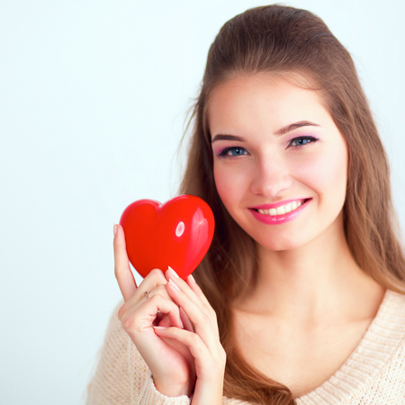 beguin: Portrait of beautiful woman hold red heart