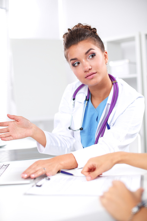 Doctor and patient sitting on the desk at office