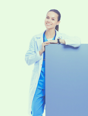 A female doctor with a blank billboard Stock Photo