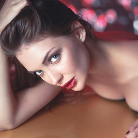 Portrait of beautiful girl with trendy makeup lying Stock Photo