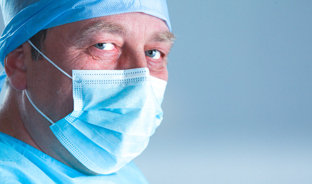 surgical mask woman: Surgeon at work in operating room.