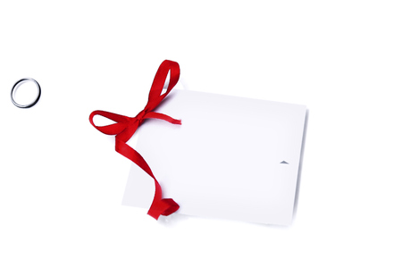 Gift card note with red ribbon on white background